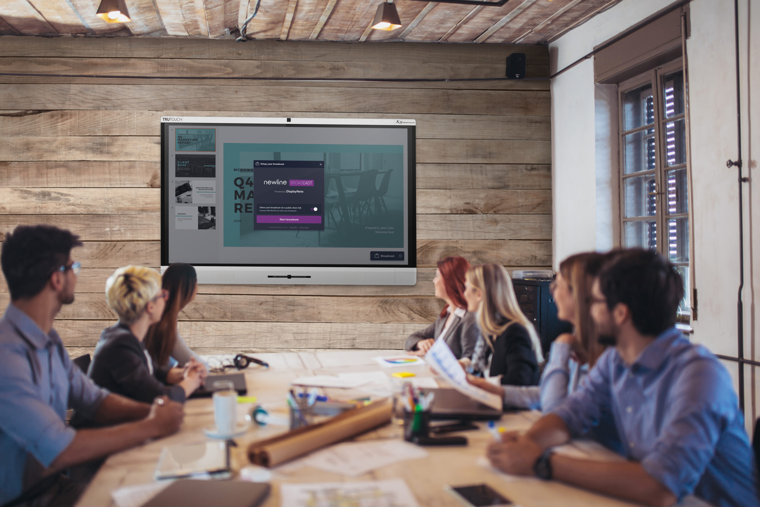 Business people looking at projector during video conference in